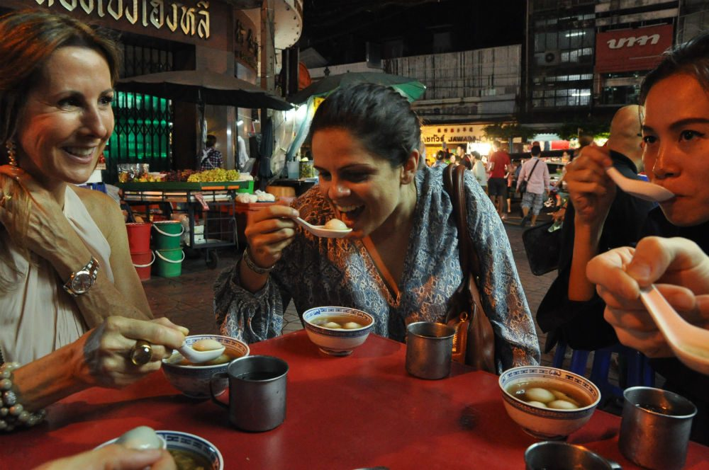 people eating street food in Thailand