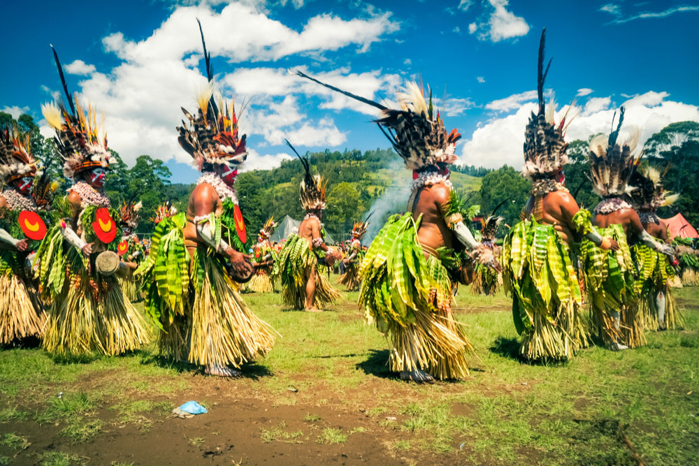 Wabag, Papua New Guinea - August 2015: Native women dance in circle during traditional Enga cultural show in Wabag, capital of Enga Province, Papua New Guinea.