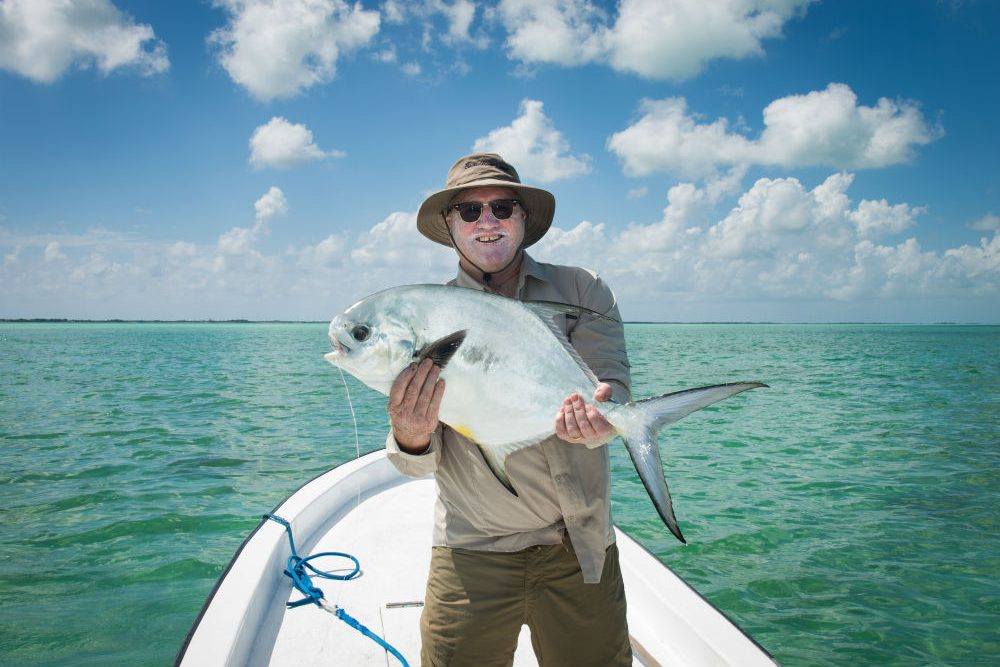 tim holding trophy fish in Belize