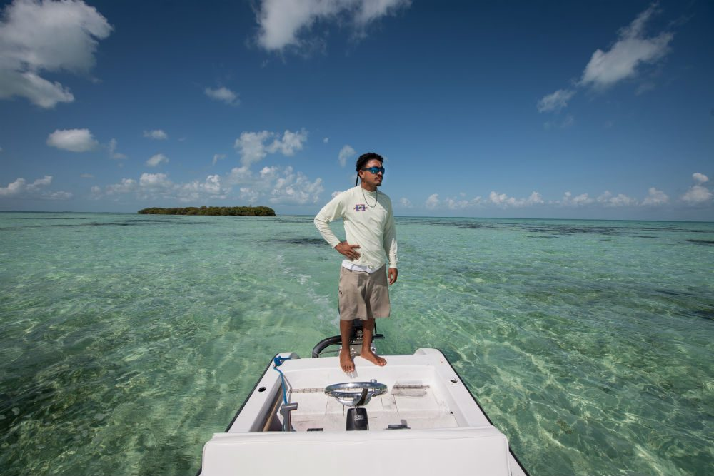 A Belize fishing guide, on the lookout for western Atlantic game fish.