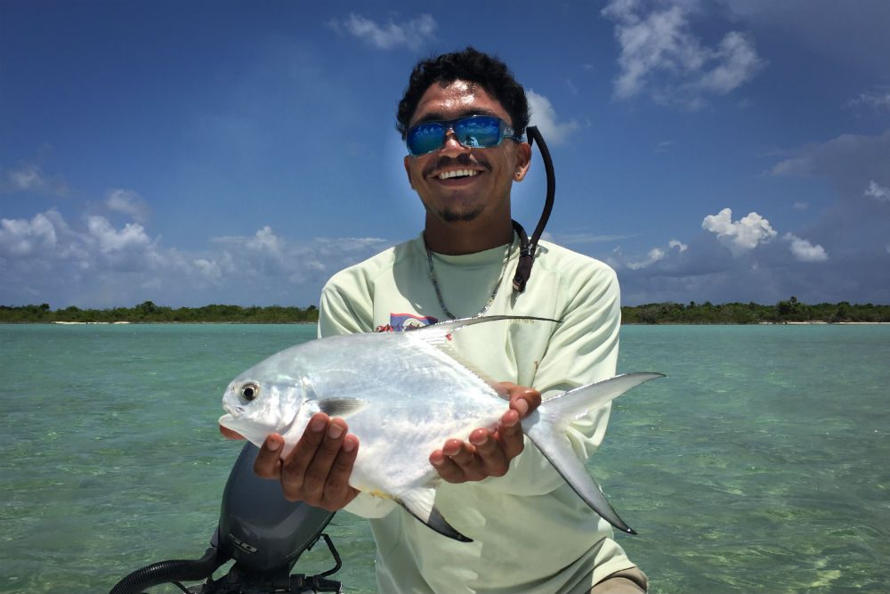 Belize fishing guide with small permit fish