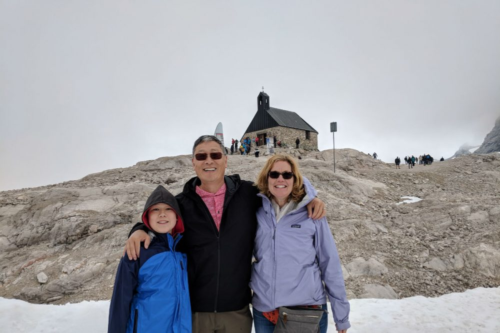 tourist family in Bavaria at top of mountain
