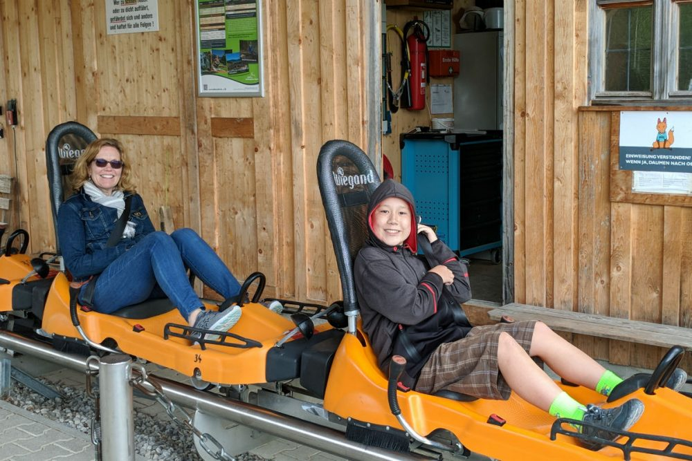 tourist family in sleds in Bavaria