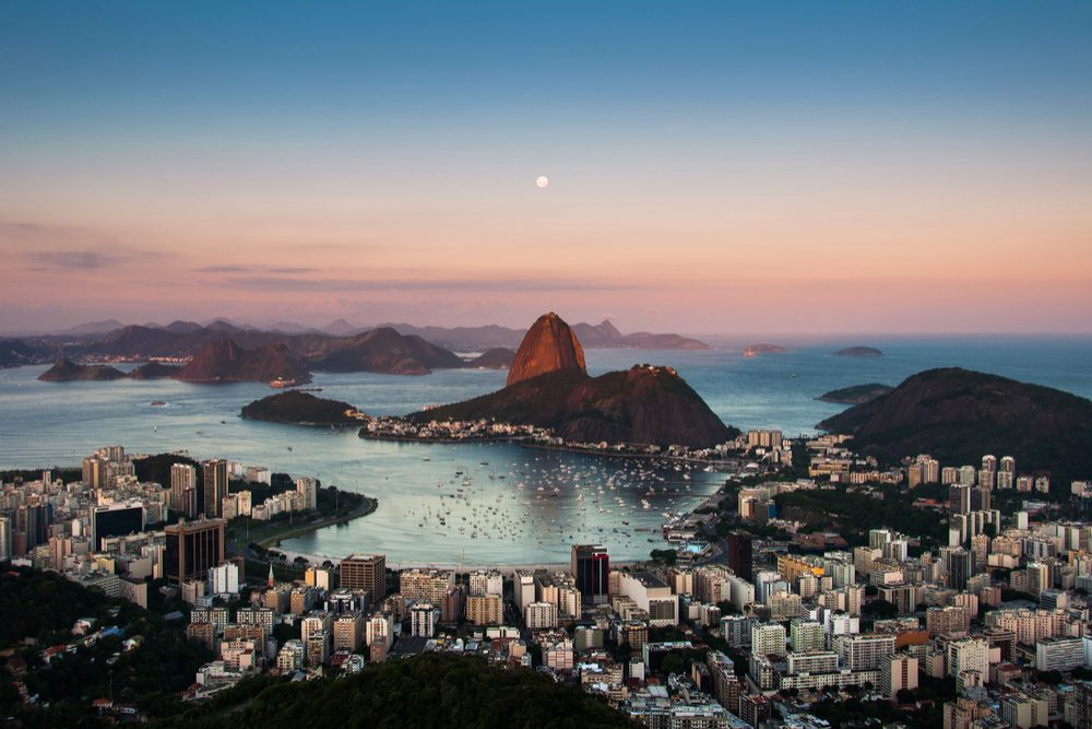 Sugarloaf Mountain and Botafogo Neighborhood in Rio de Janeiro by Sunset with Full Moon in the Sky