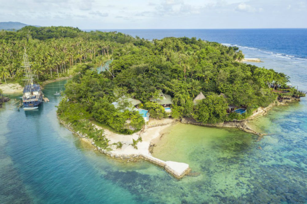 aerial view of Savasi Island, a private island resort in Fiji