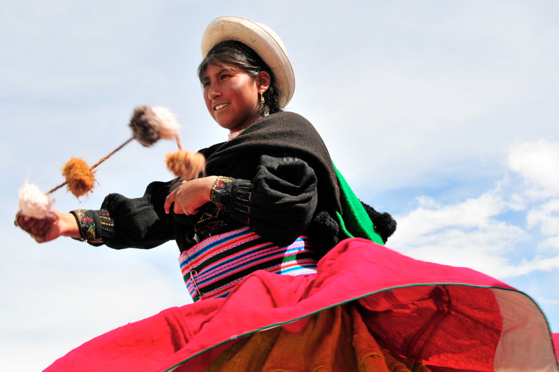 dancer in traditional Andean dress at the Fiesta de la Candelaria Lake Titicaca Peru