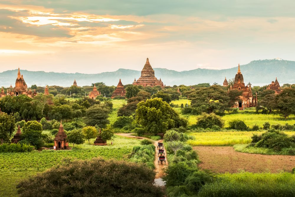 famous travel and landscape scene of ancient temples and carriages at sunset in Bagan, Myanmar