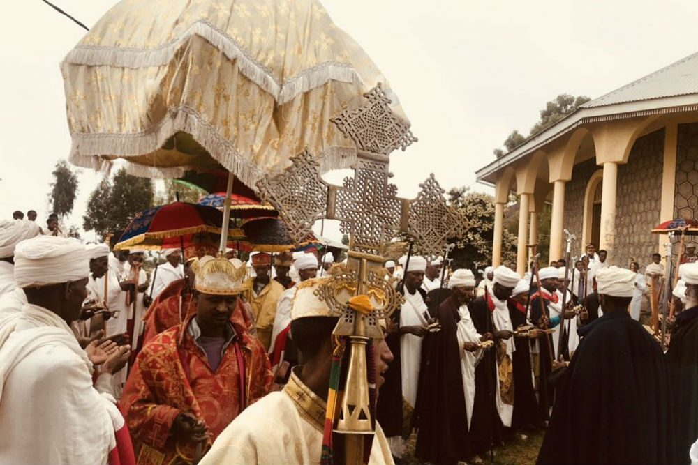 ethiopian church ceremony with many priests walking in procession