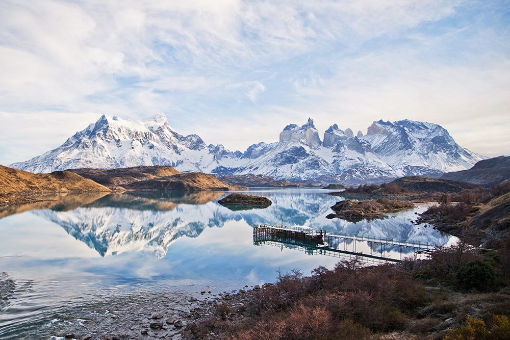 snowy landscape of mountains and lake in Torres Del Paine National Park Chile