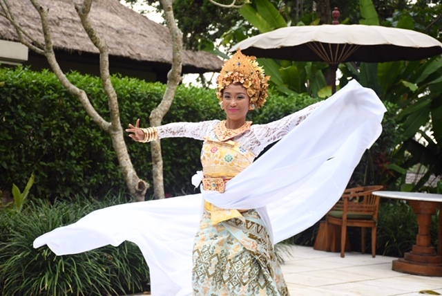 Balinese dancer Dewi Aryani performs for travelers during a special presentation