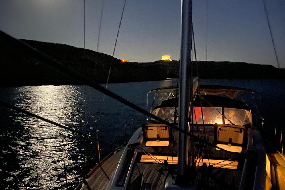 night view from the deck of a sailboat in Malta