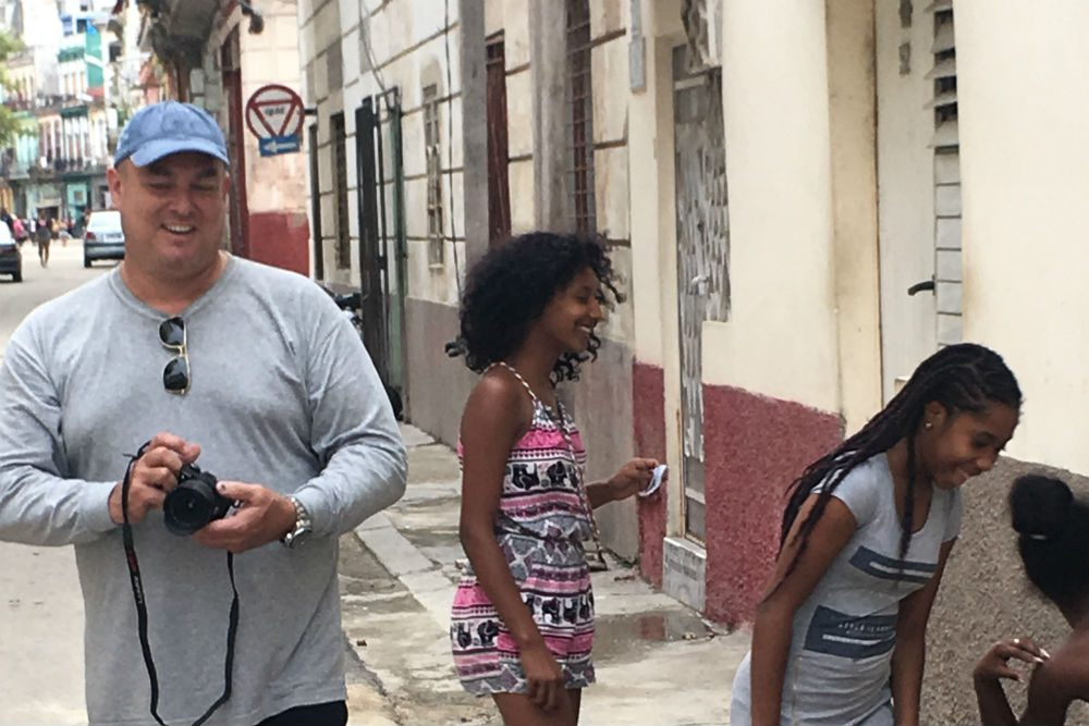 Cuban photographer Alex Castro with teenagers