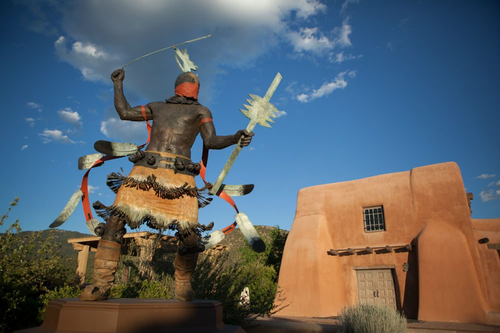 Apache Mountain Spirit Dancer statue in front of the Museum of Indian Arts and Culture in Santa Fe New Mexico