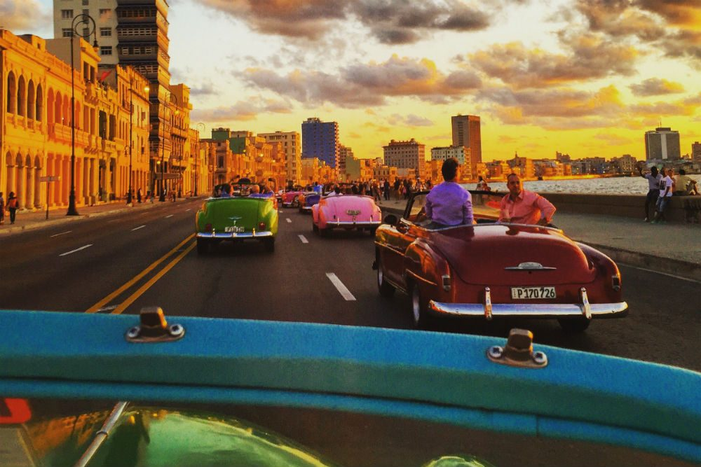 Cuba street view with cars CR Cultural Cuba photog Natasha F Gomez sunset colors and cars