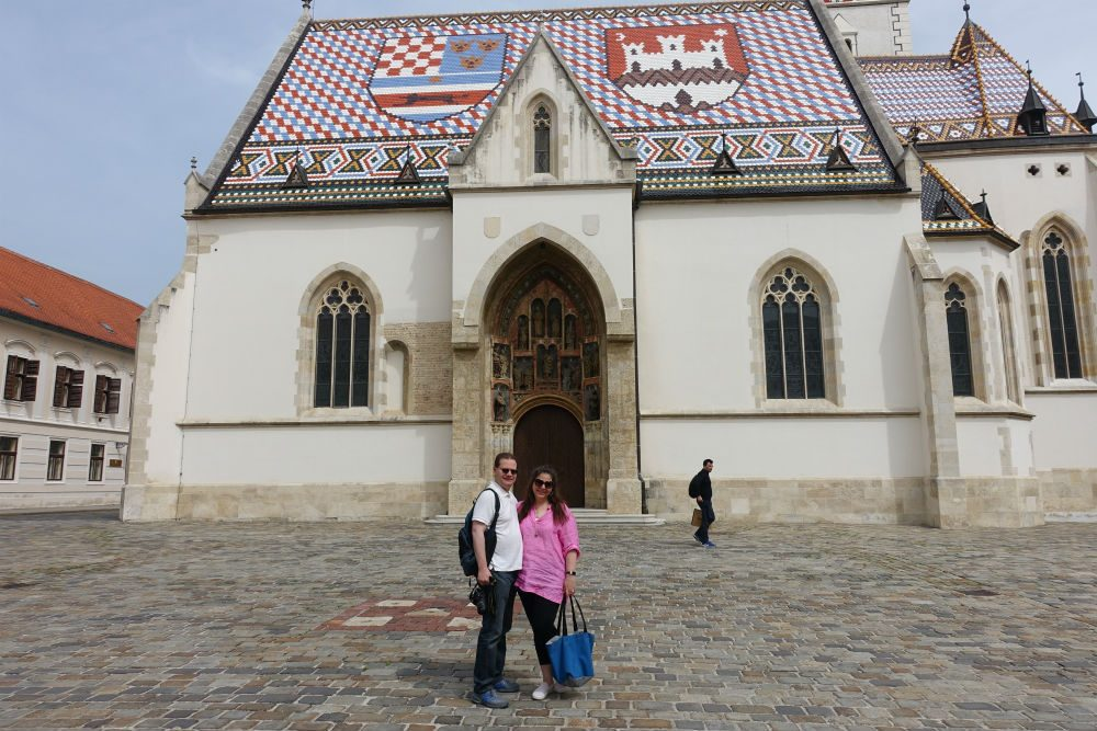 St. Marks Church Zagreb with tourists posing in front