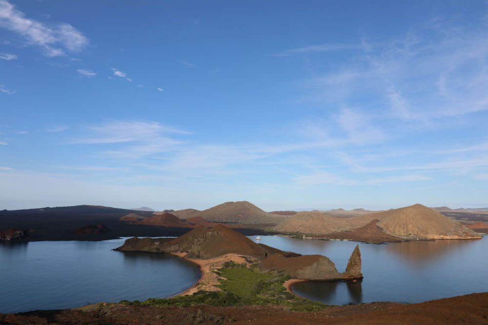 Bartolome Islet and Santiago Island: This is the iconic postcard view of the Galapagos Islands