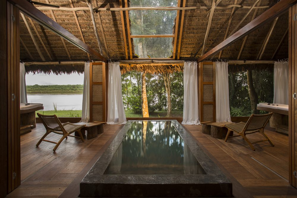 Inkaterra Machu Picchu Pueblo Hotel spa room with plunge pool and open walls surrounded by jungle