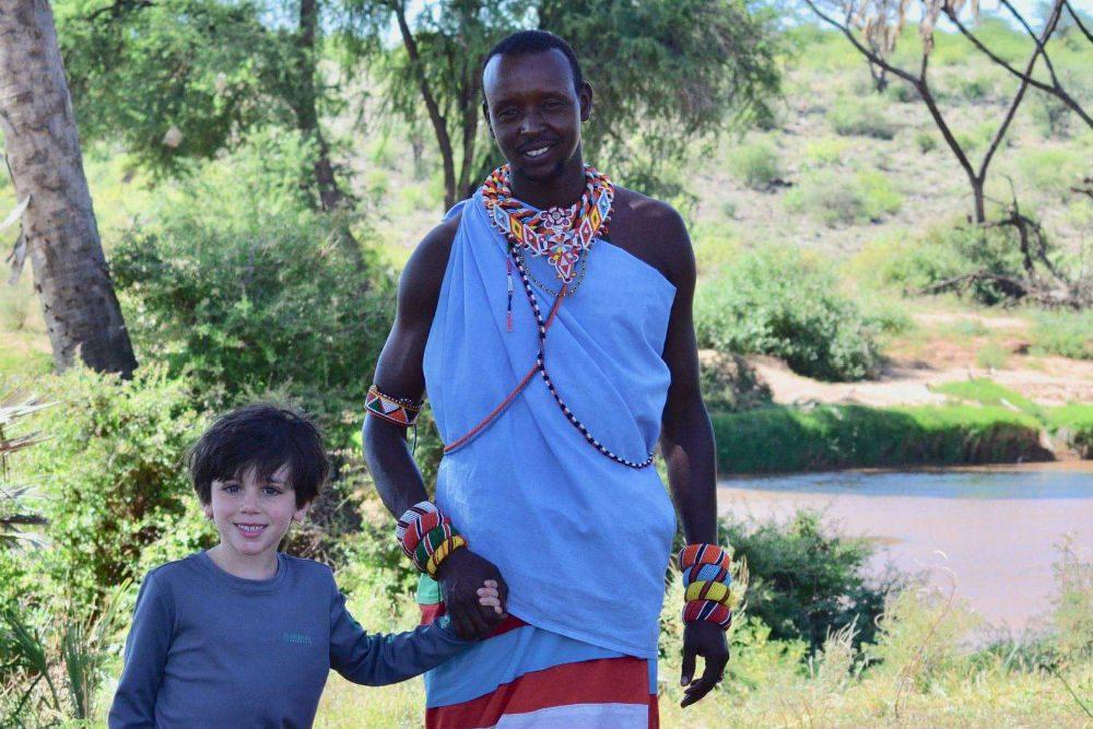Kenya Maasai Warrior with tourist child