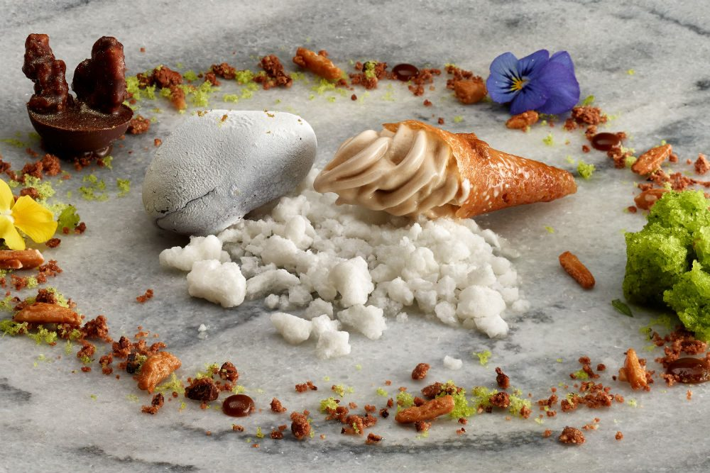 Plates at the three-Michelin-starred Martin Berasategui in Basque Country Spain resemble art, like this dessert of Pacari cocoa stones and iced flower tea.