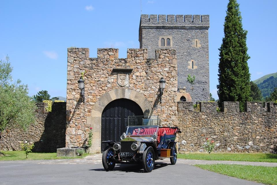 An antique rolls royce parked outside the Torre Loizaga, a renovated tower house and museum in Basque Country Spain