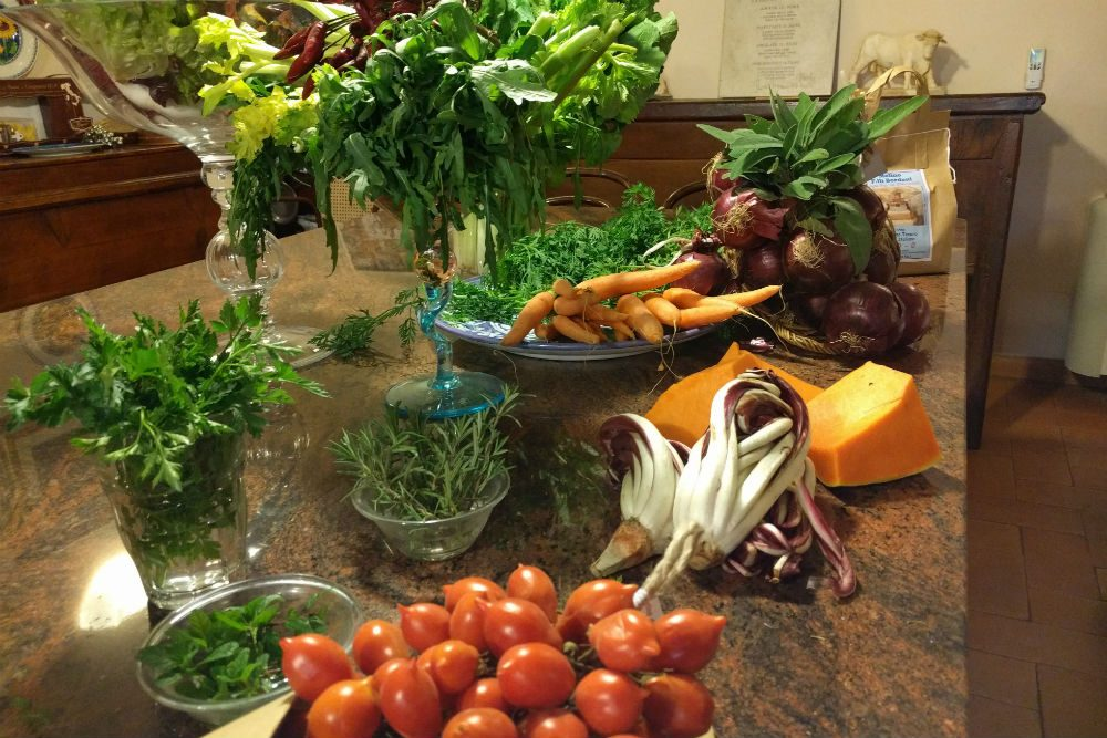 fresh vegetables laid out on a table ready for cooking