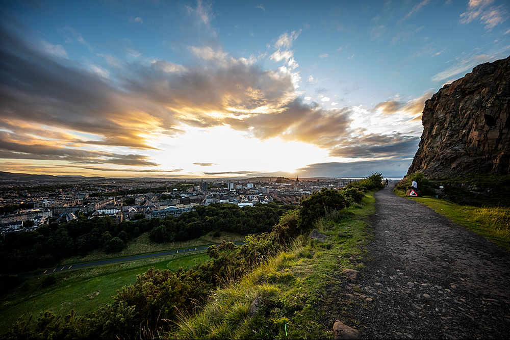 View from Salisbury Crags at sunset. Footpath along the cliffs at the top of a subsidiary spur of Arthur's Seat which rise on the west of Holyrood Park, overlooking Edinburgh.