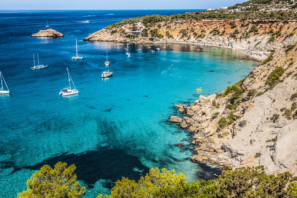 Bay with sailboats in Cala d Hort IBIZA Spain