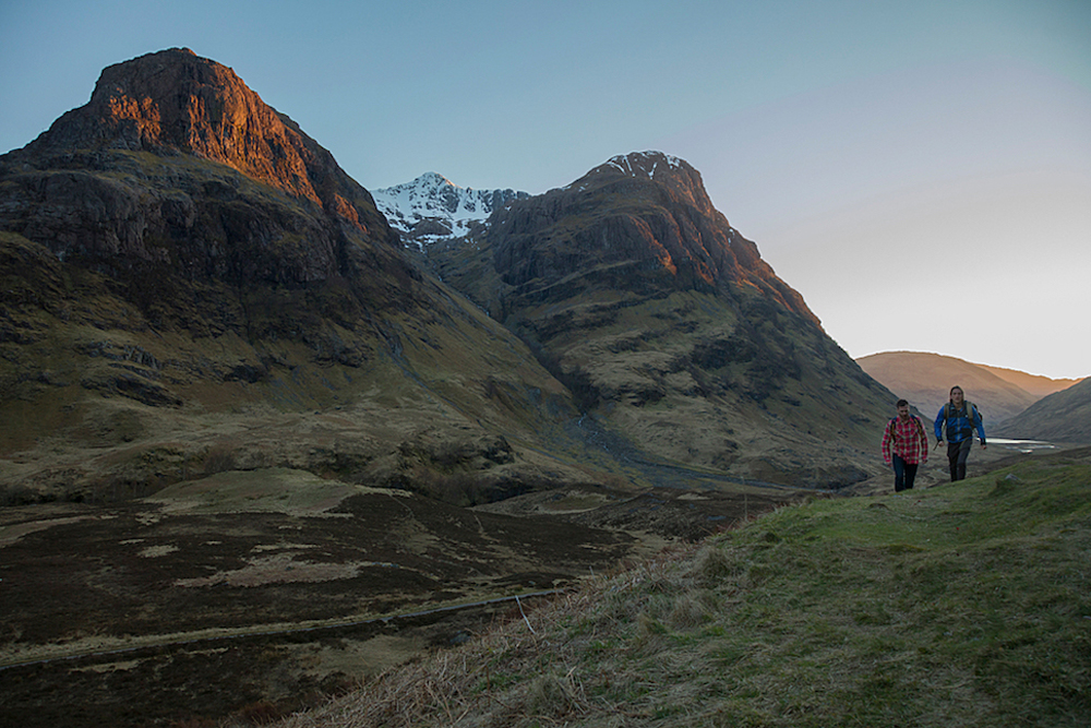 Two men hiking at Coire nan Lochan, a corrie of Bidean nam Bian, Glencoe, Scottish Highlands.