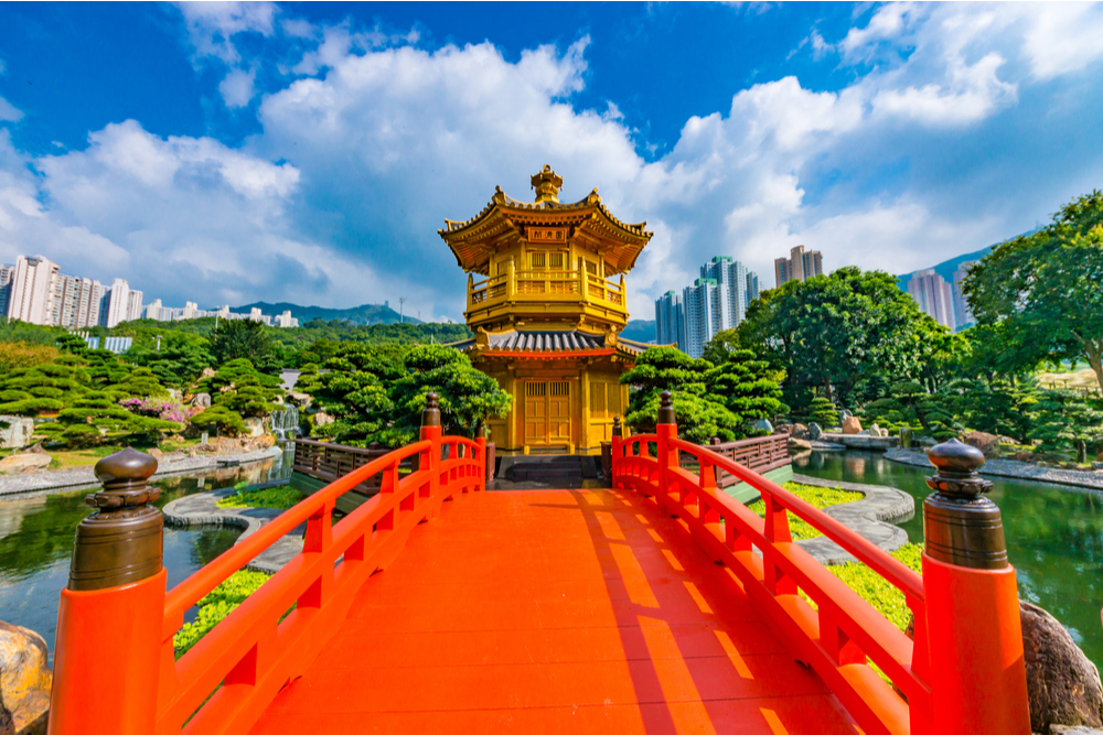 Golden pagoda of Nan lian garden in Hong Kong city with beautiful background - Image