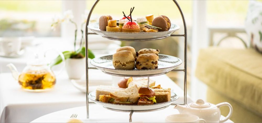 three-tiered serving platter of sandwiches and pastries for scottish afternoon tea at old course hotel