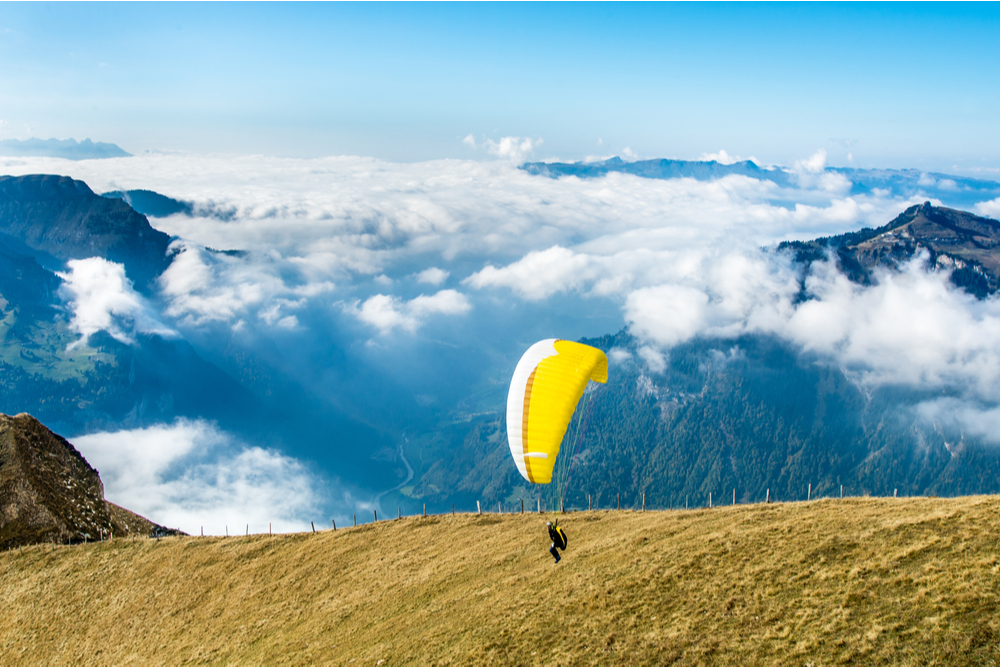 Start of paraglider at Mannlichen top point above Grindelwald, Switzerland. - Image
