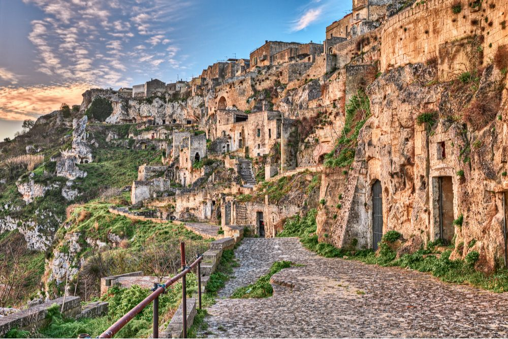 Matera, Basilicata, Italy: landscape at sunrise of the old town (sassi di Matera), with the ancient cave houses carved into the tufa rock over the deep ravine