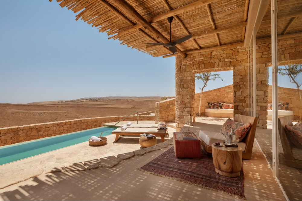 turquoise infinity pool looking out over the Negev desert at the Six Senses Shahurte