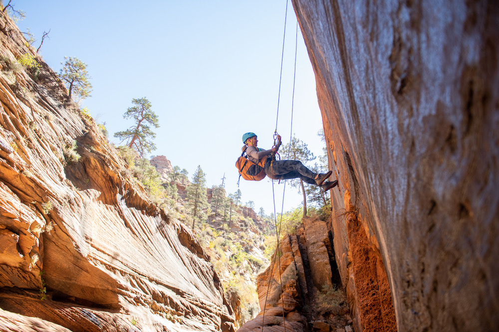 woman rappelling and rock climbing in Zion national park