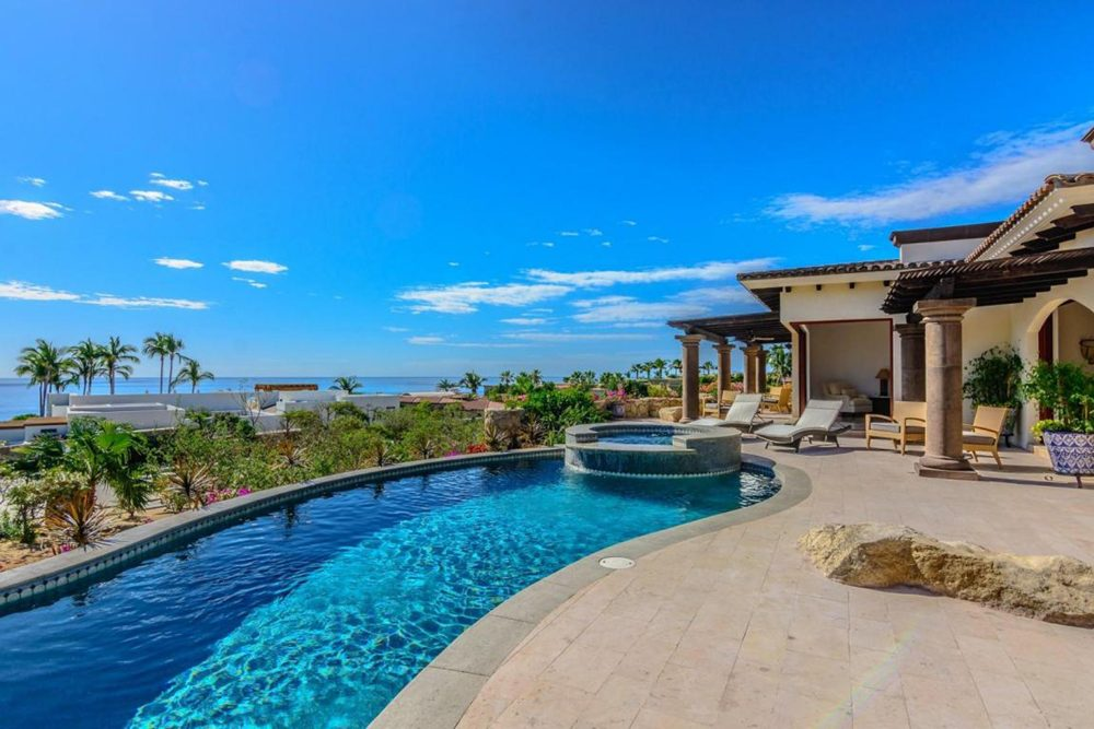 infinity pool and lounge deck at villa in Los Cabos Mexico