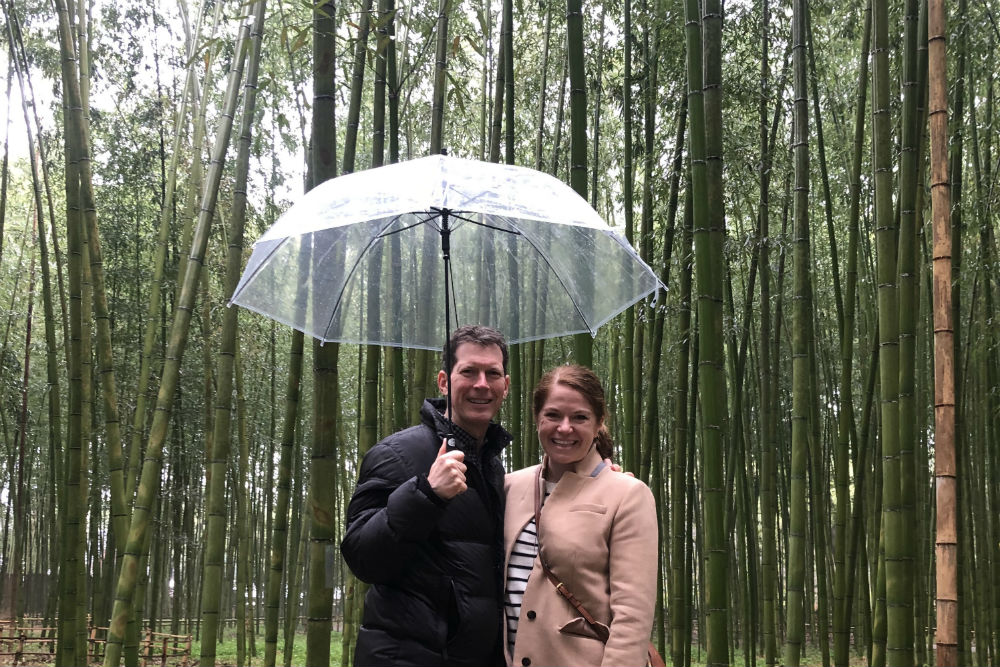 couple the bamboo forest Kyoto Japan with umbrella
