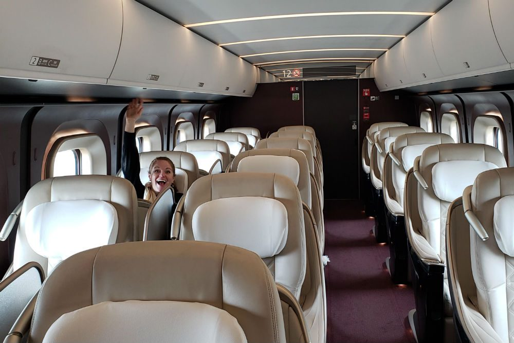 empty Shinkansen train in Japan with one traveler waving