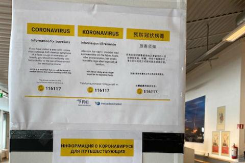 Norwegian language sign warning people about coronavirus in Kirkenes Airport Norway