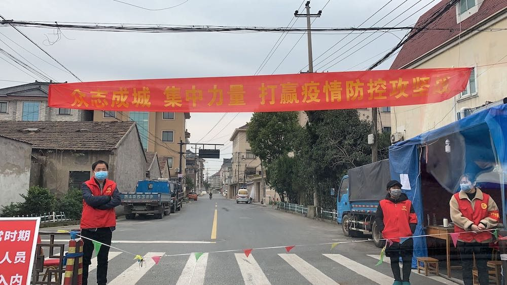 checkpoint barrier at the entrance to a local village in China during coronavirus