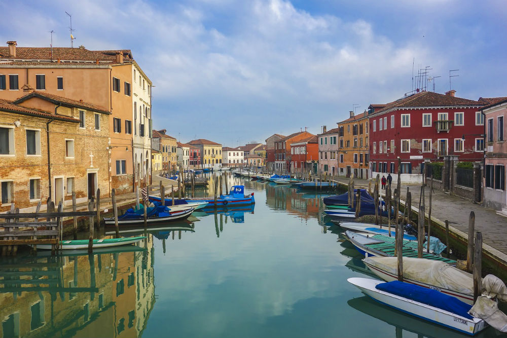venice murano island canal with boats and no crowds