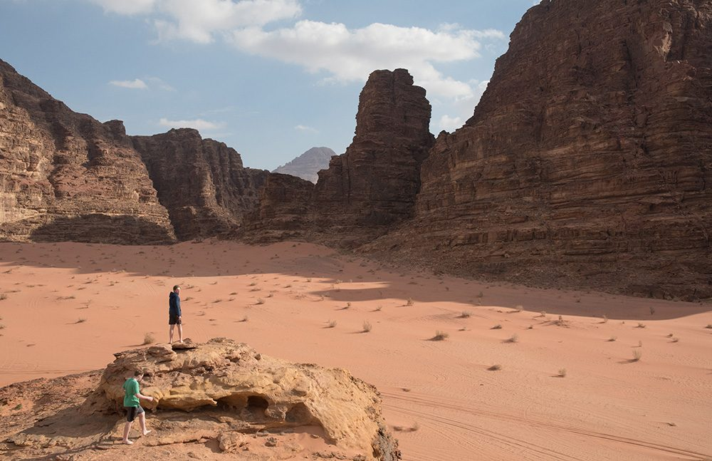 Wad Rum desert in Jordan with orange sand and large rock towers
