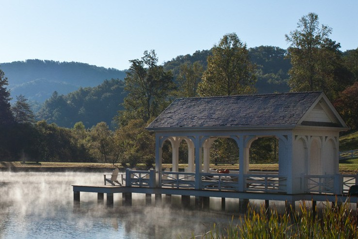 covered gazebo dock stretching into lake in tennessee at Blackberry Farm resort