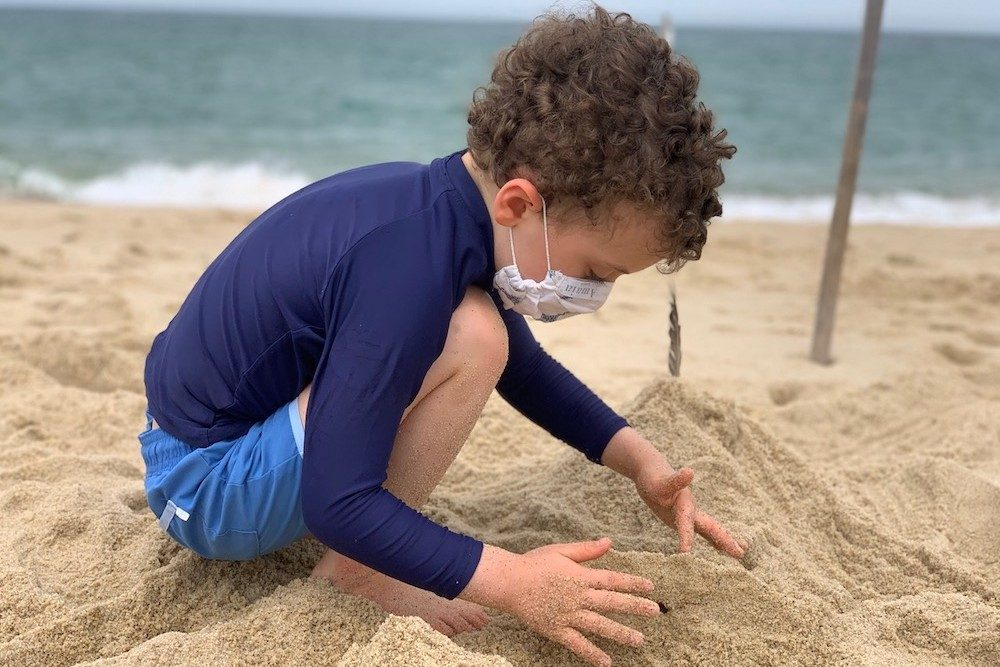 young boy Building sandcastles on the beach in Cape Cod