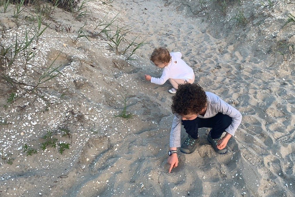 kids playing in sand at beach in Chincoteague Virginia