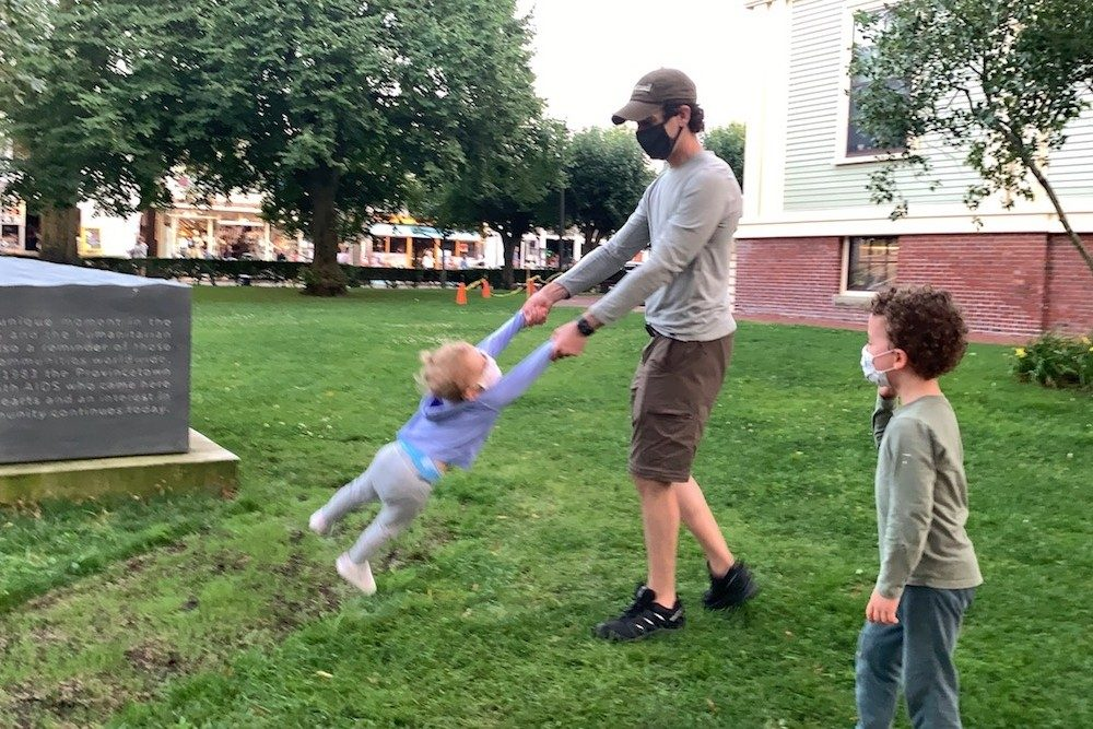 dad and kids playing in a park in Provincetown