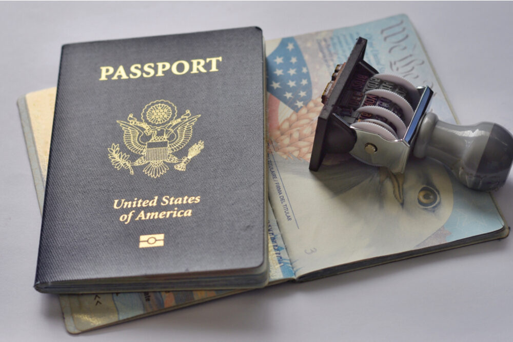 U.S.A. passport and rubber stamp on page of passport.Travel concept