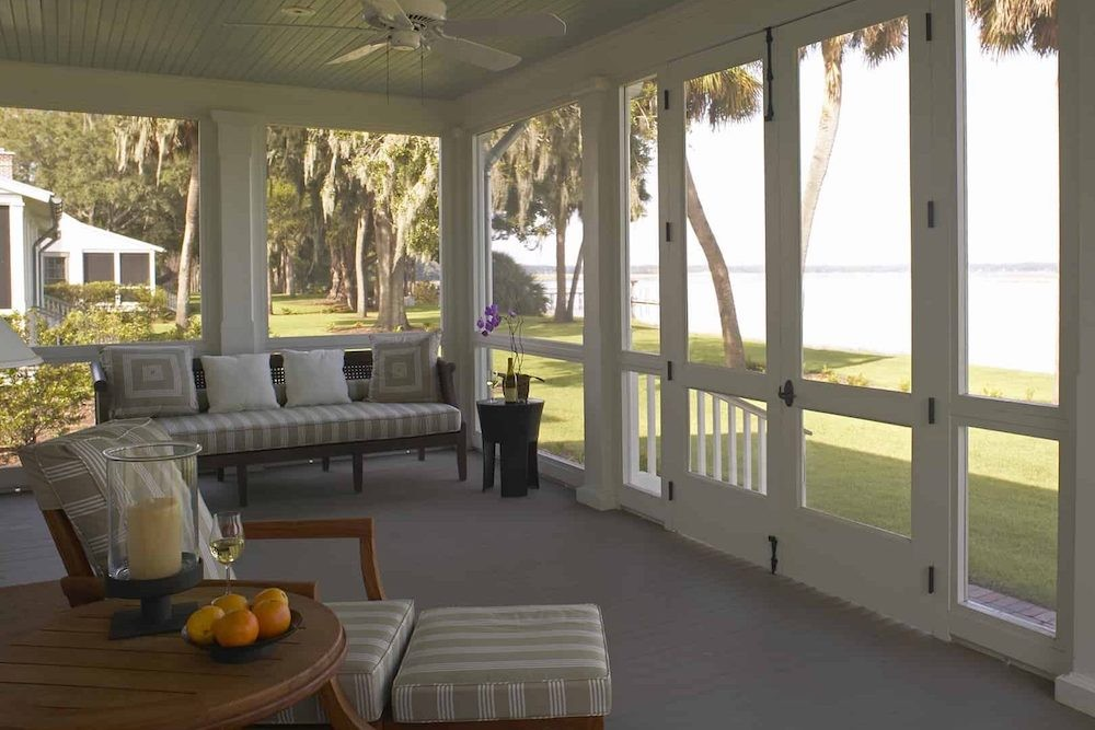 screened in porch looking out over green grass and ocean at Palmetto Bluffs Resort South Carolina