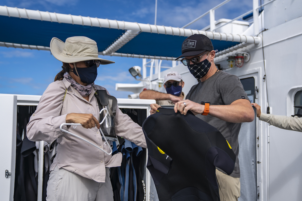Galapagos La Pinta ship giving out wetsuits to passengers