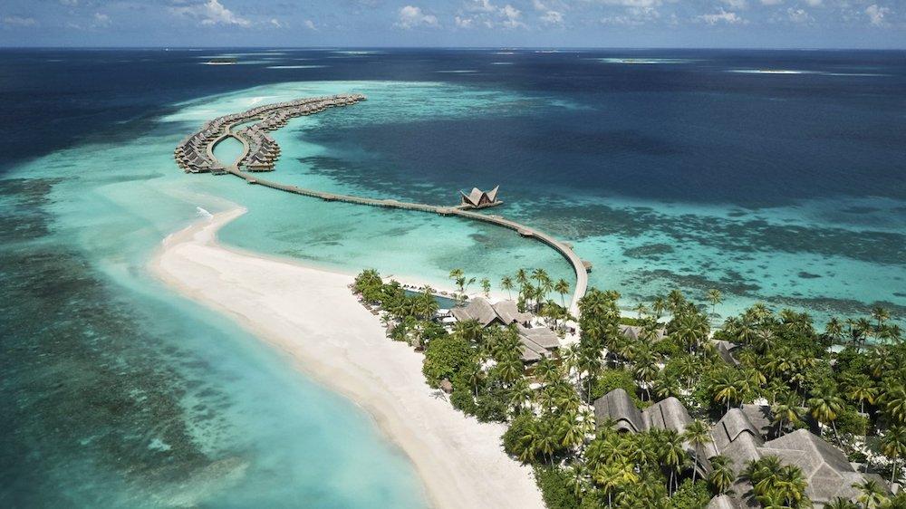 Joali Maldives overwater bungalows and beach