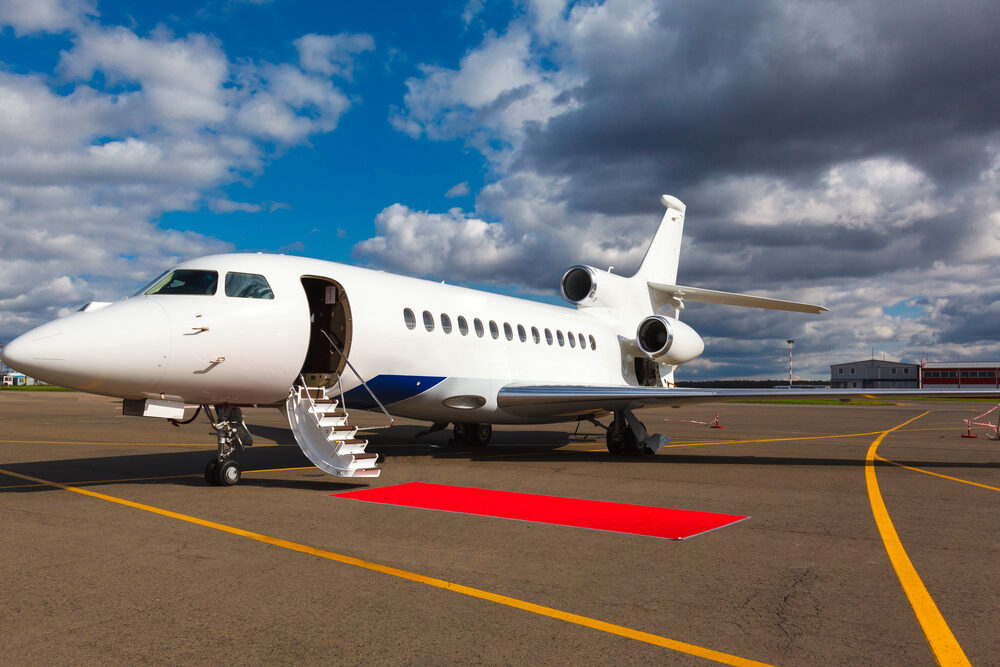 private jet with red carpet